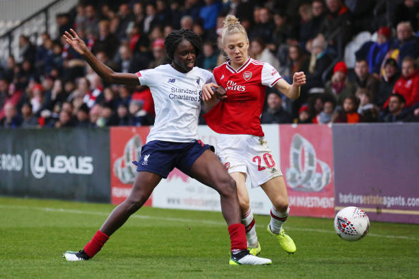BOREHAMWOOD, ENGLAND - NOVEMBER 24: Rinsola Babajide of Liverpool and Leonie Maier of Arsenal battle for the ball during the Barclays FA Women's Super League match between Arsenal and Liverpool at Meadow Park on November 24, 2019 in Borehamwood, United Kingdom. (Photo by Kate McShane/Getty Images)
