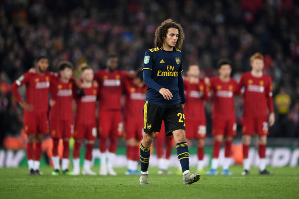 LIVERPOOL, ENGLAND - OCTOBER 30: Matteo Guendouzi of Arsenal walks towards the area to take a penalty during the penalty shoot out during the Carabao Cup Round of 16 match between Liverpool and Arsenal at Anfield on October 30, 2019 in Liverpool, England. (Photo by Laurence Griffiths/Getty Images)