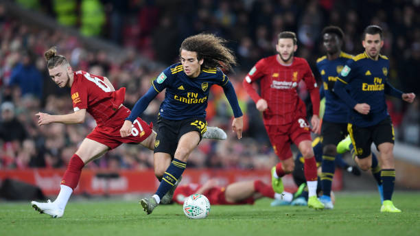 LIVERPOOL, ENGLAND - OCTOBER 30: Matteo Guendouzi of Arsenal is challenged by Harvey Elliott of Liverpool during the Carabao Cup Round of 16 match between Liverpool and Arsenal at Anfield on October 30, 2019 in Liverpool, England. (Photo by Laurence Griffiths/Getty Images)