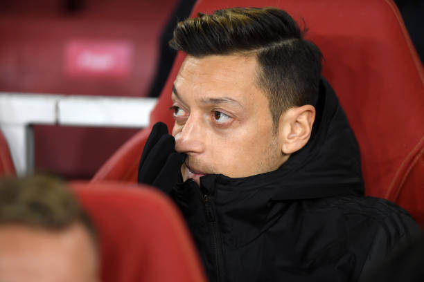 LONDON, ENGLAND - NOVEMBER 28: Mesut Ozil of Arsenal looks on from the substitute bench ahead of the UEFA Europa League group F match between Arsenal FC and Eintracht Frankfurt at Emirates Stadium on November 28, 2019 in London, United Kingdom. (Photo by Mike Hewitt/Getty Images)