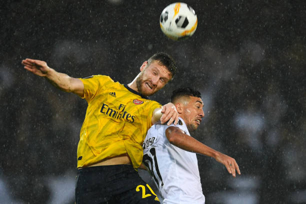 GUIMARAES, PORTUGAL - NOVEMBER 06: Shkodran Mustafi of Arsenal battles for possession with in the air with Davidson of Vitoria Guimaraes during the UEFA Europa League group F match between Vitoria Guimaraes and Arsenal FC at Estadio Dom Afonso Henriques on November 06, 2019 in Guimaraes, Portugal. (Photo by Octavio Passos/Getty Images)