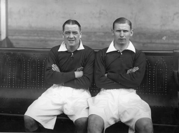 Arsenal footballers Cliff Bastin (right), the most accomplished winger of his generation, and Alex James (left). Original Publication: People Disc - HD0439 (Photo by London Express/Getty Images)
