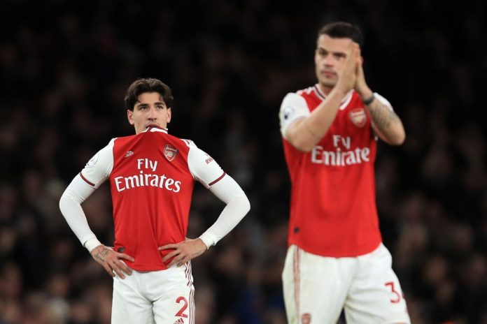 LONDON, ENGLAND - DECEMBER 05: A dejected Hector Bellerin and Granit Xhaka of Arsenal during the Premier League match between Arsenal FC and Brighton & Hove Albion at Emirates Stadium on December 5, 2019, in London, United Kingdom. (Photo by Marc Atkins/Getty Images)