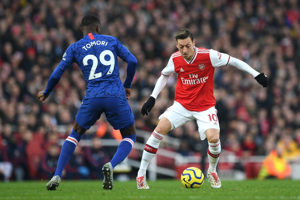 LONDON, ENGLAND - DECEMBER 29: Mesut Ozil of Arsenal takes on Fikayo Tomori of Chelsea during the Premier League match between Arsenal FC and Chelsea FC at Emirates Stadium on December 29, 2019, in London, United Kingdom. (Photo by Shaun Botterill/Getty Images)