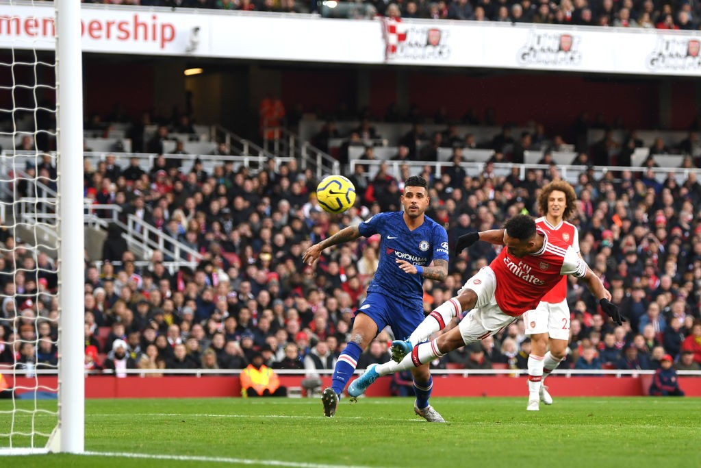 LONDON, ENGLAND - DECEMBER 29: Pierre-Emerick Aubameyang of Arsenal scores his sides first goal during the Premier League match between Arsenal FC and Chelsea FC at Emirates Stadium on December 29, 2019, in London, United Kingdom. (Photo by Shaun Botterill/Getty Images)
