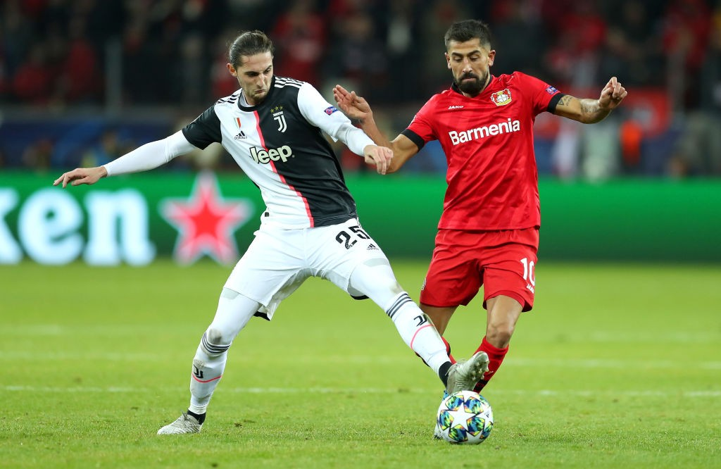 LEVERKUSEN, GERMANY - DECEMBER 11: Kerem Demirbay of Bayer 04 Leverkusen (R) is challenged by Adrien Rabiot of Juventus during the UEFA Champions League group D match between Bayer Leverkusen and Juventus at BayArena on December 11, 2019, in Leverkusen, Germany. (Photo by Lars Baron/Getty Images)