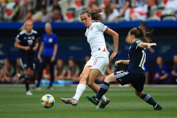NICE, FRANCE - JUNE 09: Jill Scott of England in action with Christie Murray of Scotland during the 2019 FIFA Women's World Cup France group D match between England and Scotland at Stade de Nice on June 9, 2019 in Nice, France. (Photo by Marc Atkins/Getty Images)