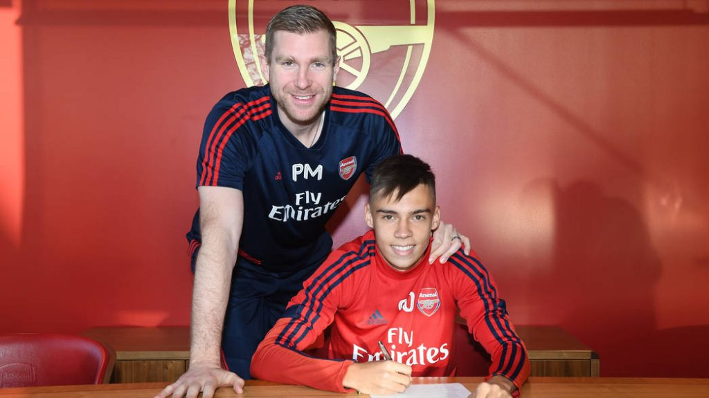 ST ALBANS, ENGLAND - DECEMBER 11: Catalin Cirjan signs his 1st Arsenal pro contract at London Colney on December 11, 2019 in St Albans, England. (Photo by Stuart MacFarlane/Arsenal FC via Getty Images)