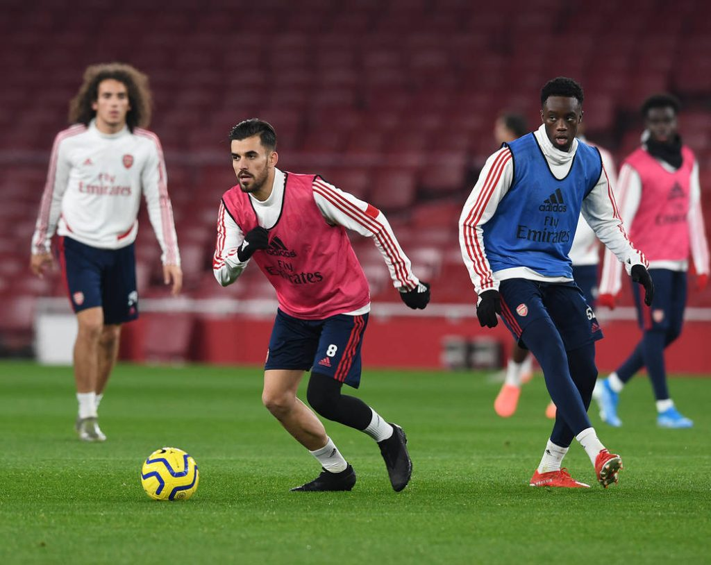 LONDON, ENGLAND - DECEMBER 28: Dani Ceballos and James Olayinka during a training session at Emirates Stadium on December 28, 2019 in London, England. (Photo by Stuart MacFarlane/Arsenal FC via Getty Images)