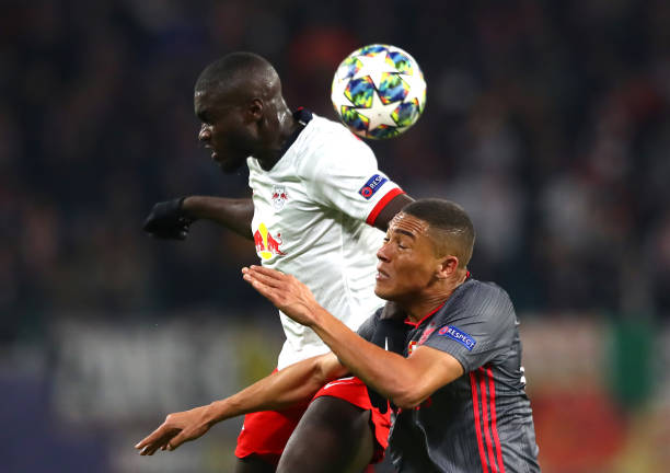 LEIPZIG, GERMANY - NOVEMBER 27: Dayot Upamecano of RB Leipzig battles for possession with Carlos Vinicius of Benfica during the UEFA Champions League group G match between RB Leipzig and SL Benfica at Red Bull Arena on November 27, 2019 in Leipzig, Germany. (Photo by Martin Rose/Bongarts/Getty Images)