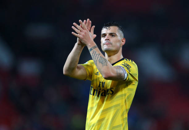 MANCHESTER, ENGLAND - SEPTEMBER 30: Granit Xhaka of Arsenal applauds after the Premier League match between Manchester United and Arsenal FC at Old Trafford on September 30, 2019 in Manchester, United Kingdom. (Photo by Catherine Ivill/Getty Images)