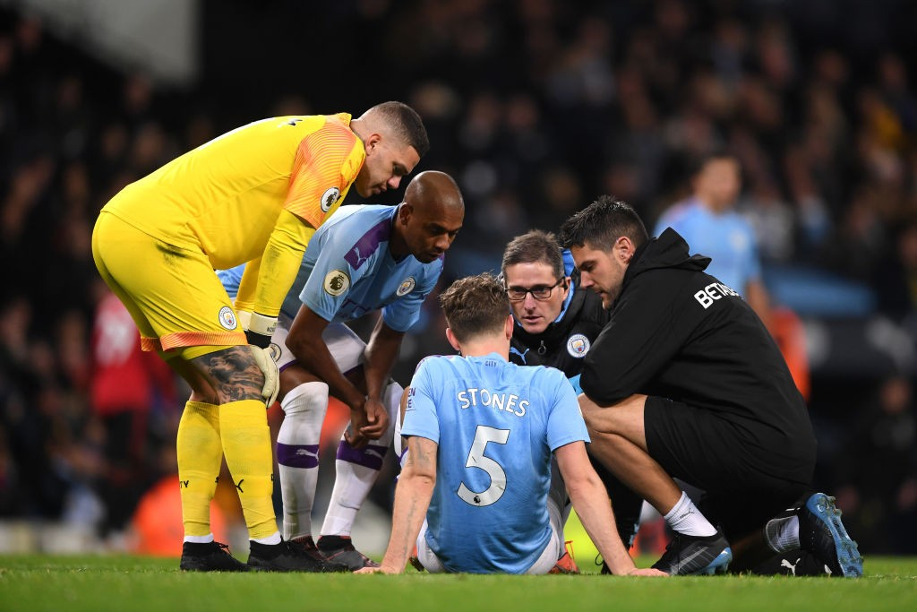 MANCHESTER, ENGLAND - DECEMBER 07: John Stones of Manchester City receives medical treatment during the Premier League match between Manchester City and Manchester United at Etihad Stadium on December 07, 2019, in Manchester, United Kingdom. (Photo by Laurence Griffiths/Getty Images)