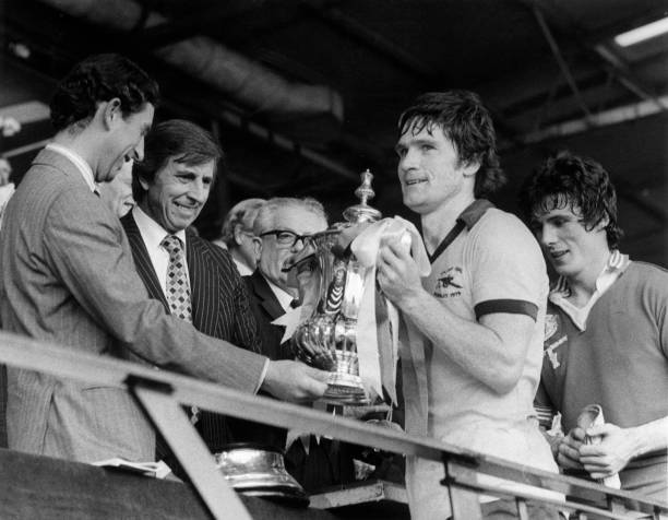 12th May 1979:  Prince Charles presenting Arsenal captain Pat Rice with the FA Cup after his team beat Manchester United 3-2. Frank Stapleton, who scored during the match, is behind him.  (Photo by Mike Stephens/Central Press/Getty Images)