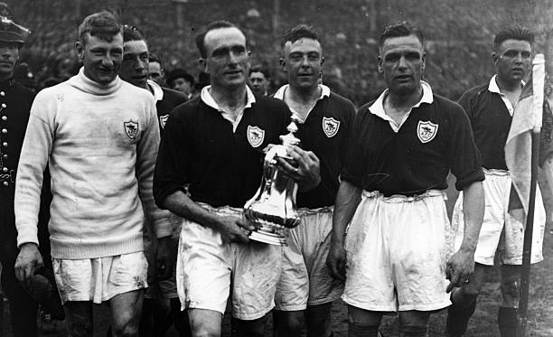 26th April 1930: Arsenal captain Tom Parker holding the FA Cup after beating Huddersfield 2-0 at Wembley. (Photo by Central Press/Getty Images)