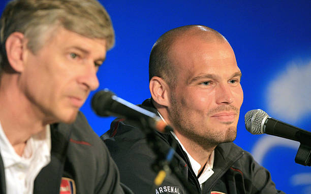 Saint-Denis, FRANCE: Arsenal midfielder Feddie Ljungberg (R) and manager Arsene Wenger give a press conference at Stade de France in St Denis, 16 May 2006 on the eve of the UEFA Champions league final being played in the French capital 17 May between English side Arsenal and Spanish team Barcelona.AFP PHOTO / ODD ANDERSEN
