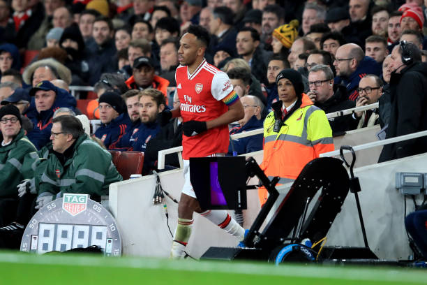 LONDON, ENGLAND - DECEMBER 05: Pierre-Emerick Aubameyang of Arsenal runs back to the pitch after making a brief exit during a break in play during the Premier League match between Arsenal FC and Brighton & Hove Albion at Emirates Stadium on December 5, 2019 in London, United Kingdom. (Photo by Marc Atkins/Getty Images)