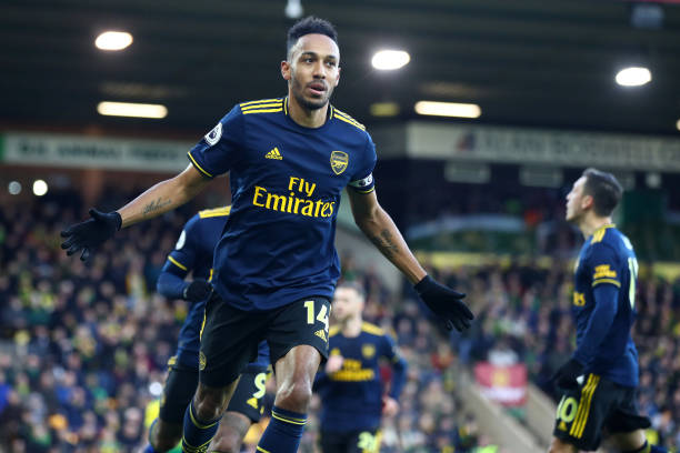 NORWICH, ENGLAND - DECEMBER 01: Pierre-Emerick Aubameyang of Arsenal celebrates scoring his sides first goal during the Premier League match between Norwich City and Arsenal FC at Carrow Road on December 01, 2019 in Norwich, United Kingdom. (Photo by Julian Finney/Getty Images)