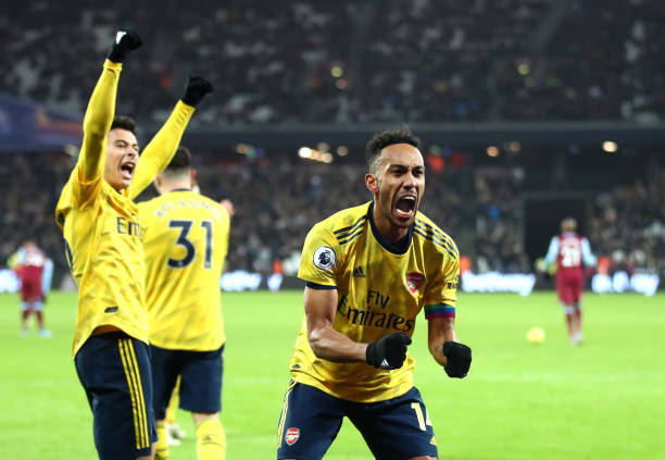 LONDON, ENGLAND - DECEMBER 09: Pierre-Emerick Aubameyang of Arsenal celebrates after scores his sides third goal during the Premier League match between West Ham United and Arsenal FC at London Stadium on December 09, 2019 in London, United Kingdom. (Photo by Julian Finney/Getty Images)