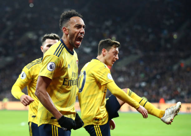 LONDON, ENGLAND - DECEMBER 09: Pierre-Emerick Aubameyang of Arsenal celebrates after he scores his sides third goal during the Premier League match between West Ham United and Arsenal FC at London Stadium on December 09, 2019 in London, United Kingdom. (Photo by Julian Finney/Getty Images)