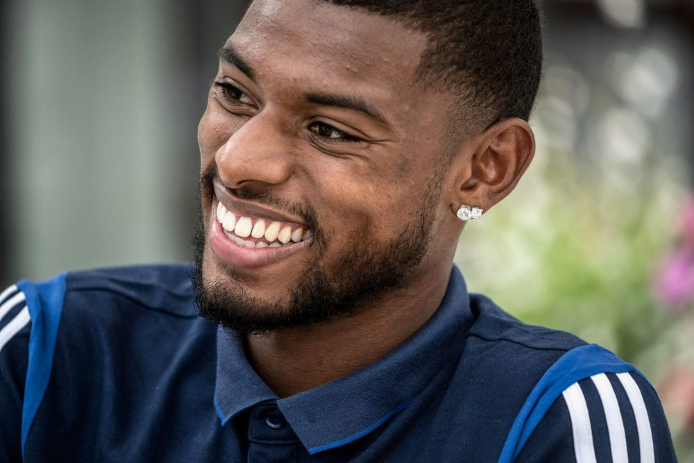 Lyon French football midfielder Jeff Reine-Adelaide answers journalists' questions, on July 1, 2020 in Evian-les-Bains, during the Olympique Lyonnais football training camp. (Photo by JEFF PACHOUD / AFP)