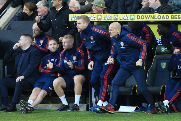 NORWICH, ENGLAND - DECEMBER 01: Interim Manager of Arsenal Freddie Ljungberg and Per Mertesacker celebrate during the Premier League match between Norwich City and Arsenal FC at Carrow Road on December 01, 2019 in Norwich, United Kingdom. (Photo by Stephen Pond/Getty Images)