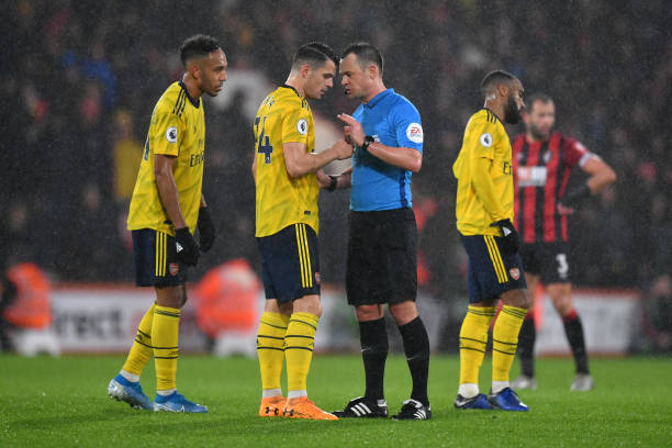 BOURNEMOUTH, ENGLAND - DECEMBER 26: Match referee Stuart Attwell speaks to Granit Xhaka of Arsenal during the Premier League match between AFC Bournemouth and Arsenal FC at Vitality Stadium on December 26, 2019 in Bournemouth, United Kingdom. (Photo by Dan Mullan/Getty Images)