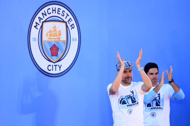 MANCHESTER, ENGLAND - MAY 20: Josep Guardiola, Manager of Manchester City and Mikel Arteta, Assistant Coach of Manchester City applaud fans during the Manchester City Teams Celebration Parade on May 20, 2019 in Manchester, England. (Photo by Nathan Stirk/Getty Images)