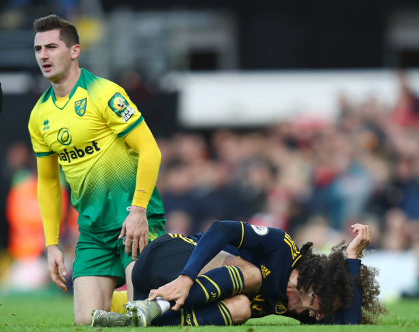 NORWICH, ENGLAND - DECEMBER 01: Matteo Guendouzi of Arsenal reacts to a tackle by Kenny McLean of Norwich City during the Premier League match between Norwich City and Arsenal FC at Carrow Road on December 01, 2019 in Norwich, United Kingdom. (Photo by Julian Finney/Getty Images)