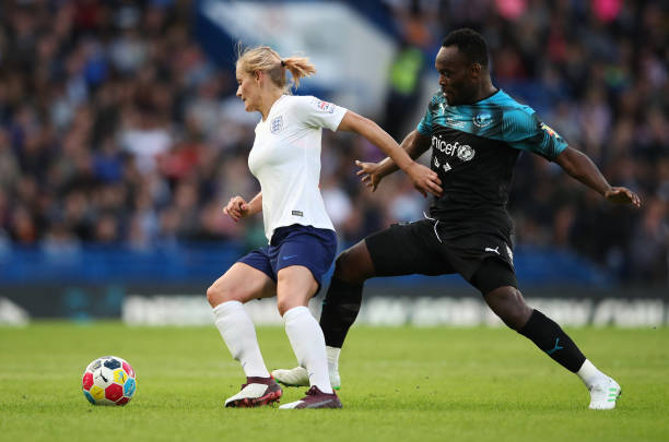 LONDON, ENGLAND - JUNE 16:  Katie Chapman of England evades Michael Essien of Soccer Aid World XI during the Soccer Aid for UNICEF 2019 match between England and the Soccer Aid World XI at Stamford Bridge on June 16, 2019 in London, England. (Photo by Alex Pantling/Getty Images)