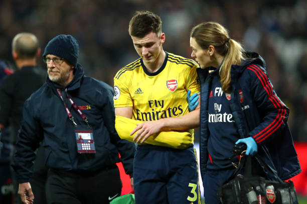 LONDON, ENGLAND - DECEMBER 09: Kieran Tierney of Arsenal leaves the pitch following an injury during the Premier League match between West Ham United and Arsenal FC at London Stadium on December 09, 2019 in London, United Kingdom. (Photo by Julian Finney/Getty Images)