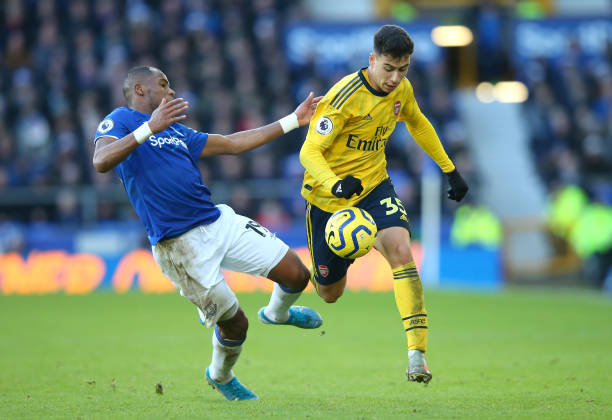 LIVERPOOL, ENGLAND - DECEMBER 21: Djibril Sidibe of Everton tackles Gabriel Martinelli of Arsenal during the Premier League match between Everton FC and Arsenal FC at Goodison Park on December 21, 2019 in Liverpool, United Kingdom. (Photo by Alex Livesey/Getty Images)