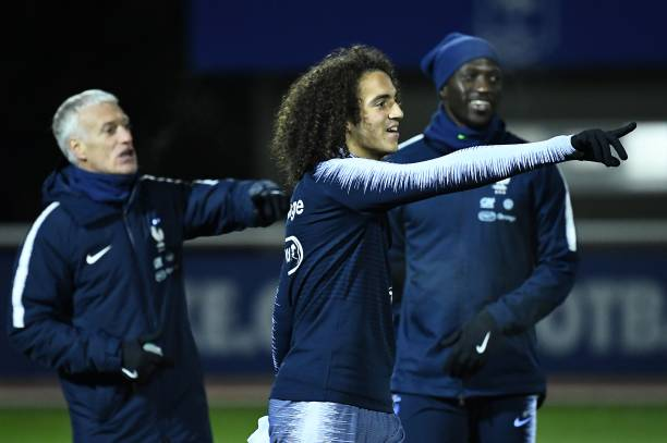 France's midfielder Matteo Guendouzi (C) gestures in front of France's head coach Didier Deschamps during a training session in Clairefontaine-en-Yvelines on November 12, 2019, as part of the team's preparation for the upcoming qualification Euro-2020 football matches against Moladavia and Albania. (Photo by FRANCK FIFE / AFP)