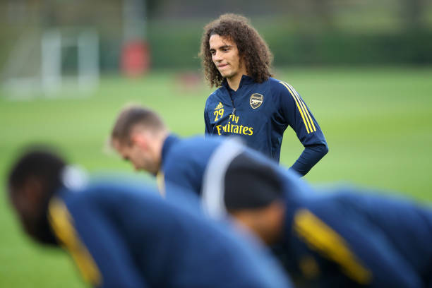 ST ALBANS, ENGLAND - NOVEMBER 27: Matteo Guendouzi looks on with team mates during an Arsenal training session on the eve of their UEFA Europa League match against Eintracht Frankfurt at London Colney on November 27, 2019 in St Albans, England. (Photo by Warren Little/Getty Images)