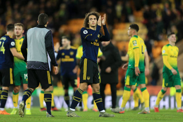 NORWICH, ENGLAND - DECEMBER 01: Matteo Guendouzi of Arsenal acknowledges fans during the Premier League match between Norwich City and Arsenal FC at Carrow Road on December 01, 2019 in Norwich, United Kingdom. (Photo by Stephen Pond/Getty Images)