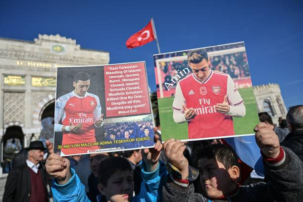 Supporters of China's Muslim Uighur minority hold placards of Arsenal's Turkish origin German midfielder Mesut Ozil during a demonstration at Beyazid square in Istanbul on December 14, 2019. - Arsenal's Mesut Ozil, a German footballer of Turkish origin, expressed on December 14, 2019 support for Uighurs in Xinjiang and criticised Muslim countries for their failure to speak up for them. (Photo by Ozan KOSE / AFP) (Photo by OZAN KOSE/AFP via Getty Images)