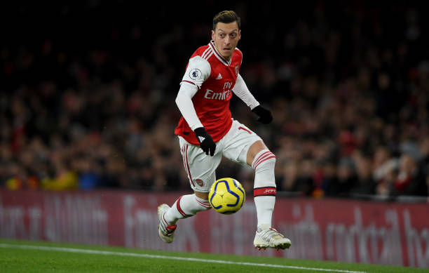 LONDON, ENGLAND - DECEMBER 05: Mesut Ozil of Arsenal runs with the ball during the Premier League match between Arsenal FC and Brighton & Hove Albion at Emirates Stadium on December 05, 2019 in London, United Kingdom. (Photo by Mike Hewitt/Getty Images)
