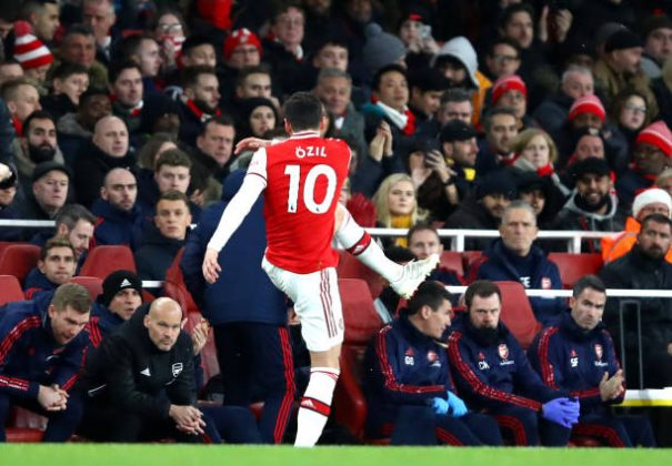 LONDON, ENGLAND - DECEMBER 15: Mesut Ozil of Arsenal kicks a water bottle as he is subbed as Interim Manager of Arsenal, Freddie Ljungberg looks on during the Premier League match between Arsenal FC and Manchester City at Emirates Stadium on December 15, 2019 in London, United Kingdom. (Photo by Julian Finney/Getty Images)