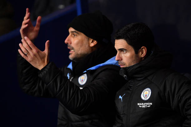 OXFORD, ENGLAND - DECEMBER 18: Mikel Arteta, Assistant Manager of Manchester City looks on as Manager of Manchester City, Josep Guardiola reacts during the Carabao Cup Quarter Final match between Oxford United and Manchester City at Kassam Stadium on December 18, 2019 in Oxford, England. (Photo by Justin Setterfield/Getty Images)