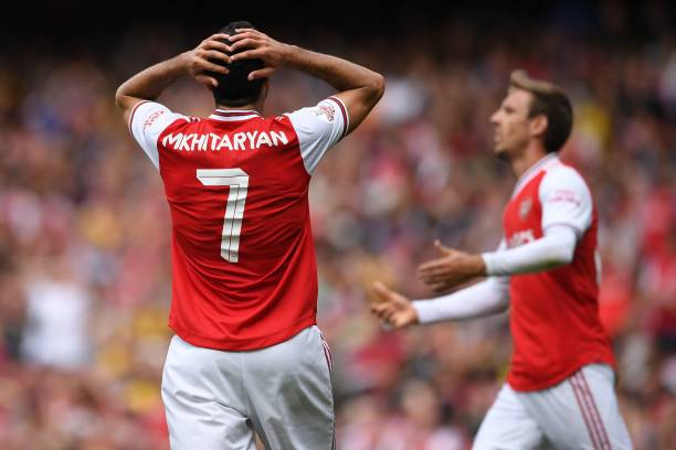 Arsenal's Armenian midfielder Henrikh Mkhitaryan (L) and Arsenal's Spanish defender Nacho Monreal (R) react to another missed chance during the pre-season friendly football match for the Emirates Cup between Arsenal and Lyon at The Emirates Stadium in north London on July 28, 2019. (Photo by Ben STANSALL / AFP)