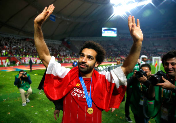 DOHA, QATAR - DECEMBER 21: Mohamed Salah of Liverpool acknowledges fans after his team's victory in the FIFA Club World Cup Qatar 2019 Final between Liverpool FC and CR Flamengo at Education City Stadium on December 21, 2019 in Doha, Qatar. (Photo by Francois Nel/Getty Images)