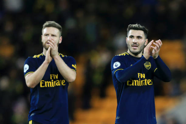 NORWICH, ENGLAND - DECEMBER 01: Sead Kolasinac of Arsenal and Shkodran Mustafi of Arsenal acknowledge the fans during the Premier League match between Norwich City and Arsenal FC at Carrow Road on December 01, 2019 in Norwich, United Kingdom. (Photo by Stephen Pond/Getty Images)