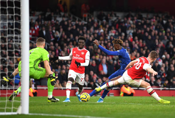 LONDON, ENGLAND - DECEMBER 29: Tammy Abraham of Chelsea scores his sides second goal during the Premier League match between Arsenal FC and Chelsea FC at Emirates Stadium on December 29, 2019 in London, United Kingdom. (Photo by Shaun Botterill/Getty Images)