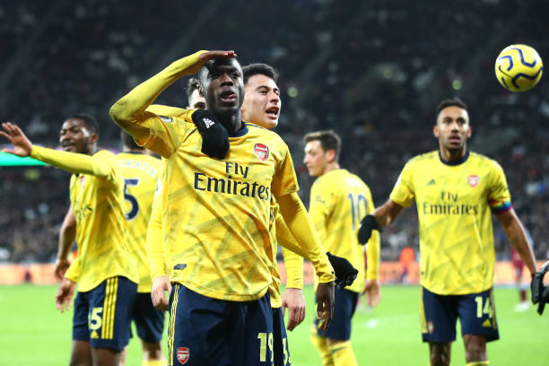 LONDON, ENGLAND - DECEMBER 09: Nicolas Pepe of Arsenal celebrates after scoring his sides second goal during the Premier League match between West Ham United and Arsenal FC at London Stadium on December 09, 2019 in London, United Kingdom. (Photo by Julian Finney/Getty Images)