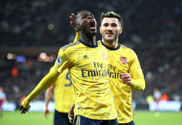 LONDON, ENGLAND - DECEMBER 09: Nicolas Pepe of Arsenal celebrates after scoring his sides second goal with Saed Kolasinac during the Premier League match between West Ham United and Arsenal FC at London Stadium on December 09, 2019 in London, United Kingdom. (Photo by Julian Finney/Getty Images)