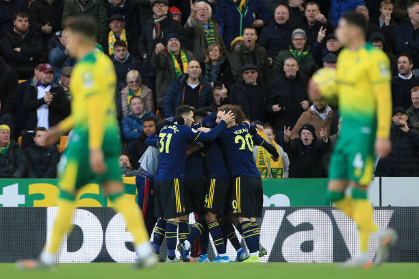 NORWICH, ENGLAND - DECEMBER 01: Pierre-Emerick Aubameyang of Arsenal celebrates with team mates after scoring his sides second goal during the Premier League match between Norwich City and Arsenal FC at Carrow Road on December 01, 2019 in Norwich, United Kingdom. (Photo by Stephen Pond/Getty Images)