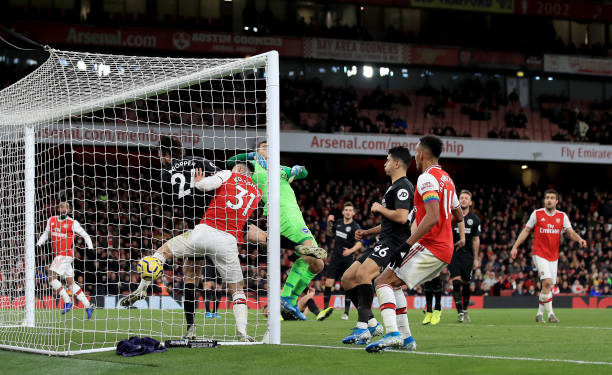 LONDON, ENGLAND - DECEMBER 05: Alexandre Lacazette of Arsenal scores his teams first goal during the Premier League match between Arsenal FC and Brighton & Hove Albion at Emirates Stadium on December 05, 2019 in London, United Kingdom. (Photo by Marc Atkins/Getty Images)