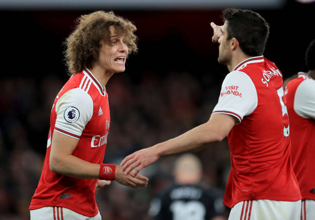 LONDON, ENGLAND - DECEMBER 05: David Luiz of Arsenal discusses with Sokratis of Arsenal during the Premier League match between Arsenal FC and Brighton & Hove Albion at Emirates Stadium on December 05, 2019 in London, United Kingdom. (Photo by Marc Atkins/Getty Images)