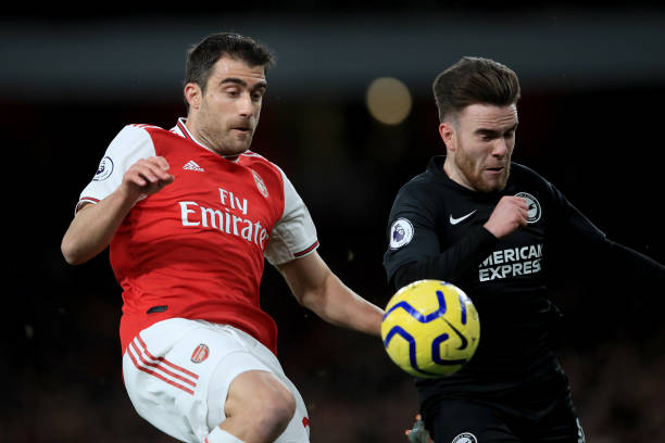 LONDON, ENGLAND - DECEMBER 05: Sokratis Papastathopoulos of Arsenal in action with Aaron Connolly of Brighton and Hove Albion during the Premier League match between Arsenal FC and Brighton & Hove Albion at Emirates Stadium on December 5, 2019 in London, United Kingdom. (Photo by Marc Atkins/Getty Images)