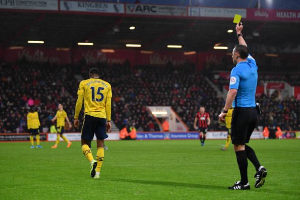 BOURNEMOUTH, ENGLAND - DECEMBER 26: Ainsley Maitland-Niles of Arsenal is shown a yellow card by referee Stuart Attwell during the Premier League match between AFC Bournemouth and Arsenal FC at Vitality Stadium on December 26, 2019 in Bournemouth, United Kingdom. (Photo by Dan Mullan/Getty Images)