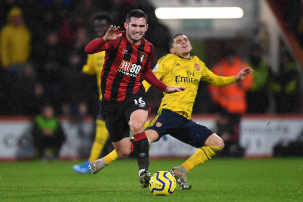BOURNEMOUTH, ENGLAND - DECEMBER 26: Lewis Cook of AFC Bournemouth is challenged by Lucas Torreira of Arsenal during the Premier League match between AFC Bournemouth and Arsenal FC at Vitality Stadium on December 26, 2019 in Bournemouth, United Kingdom. (Photo by Harriet Lander/Getty Images)